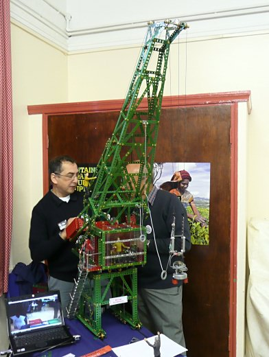 Alan (left) operating his robotic crane
