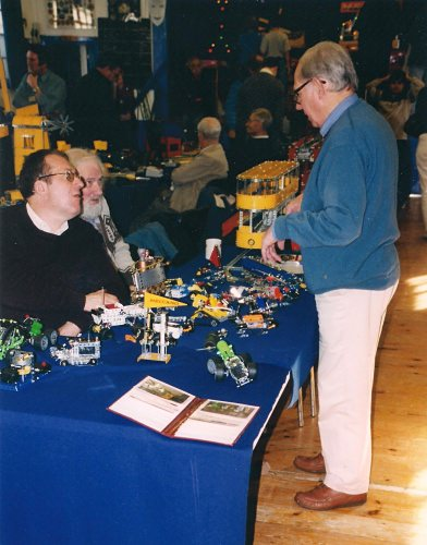 Geoff Davison (standing) chats to Peter Clay and Geoff Carter at our 25th exhibition in October 2003 at the 3rd Bromley Scouts Group Hall