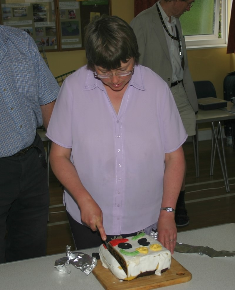Cathy Warrell cutting the birthday cake at our 30th anniversary meeting on 24th June 2006