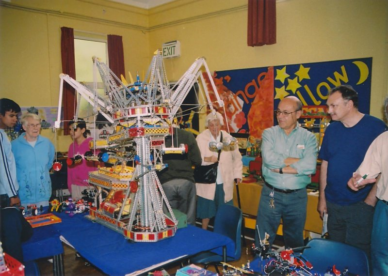 Santiago Plicio (standing in light blue shirt) demonstrates one of his fairground rides at our 28th exhibition on 14th October 2006 at Eltham United Reformed Church