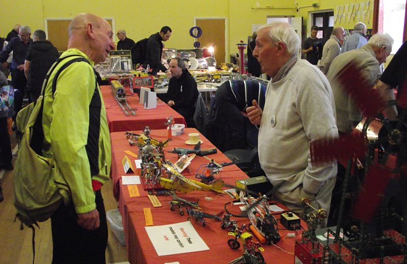 John Cowdery (right) talking to a visitor about his models