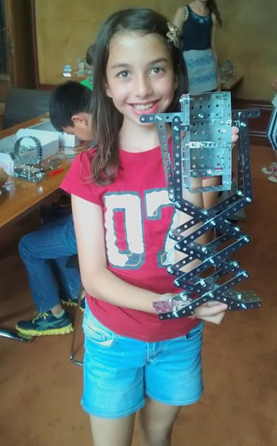 One of the budding architects shows off her clever scissor lift mechanism