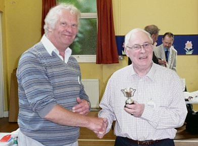 Frank Paine (left) awards the Cup to Jim MacCulloch