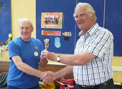 Frank Paine (right) awards the Cup to Chris Fry
