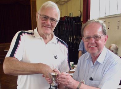 Adrian Ashford (right) awards the Cup to Alan Wenbourne
